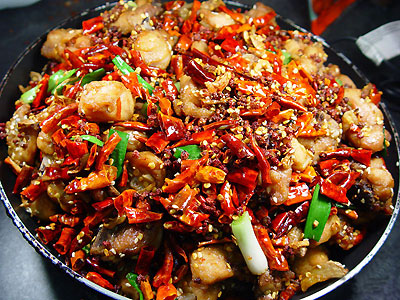Which province in china is famous for having very spicy for Asian cuisine information